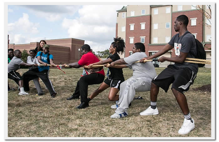 Image of students competing in a tug of war